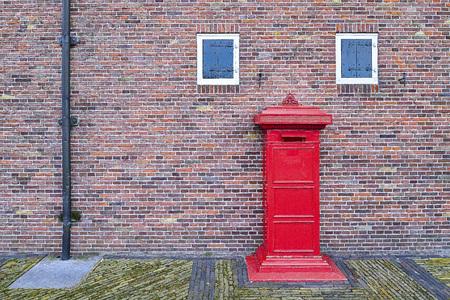 Post Box and Old Vintage Brick Wall Background Фото со стока