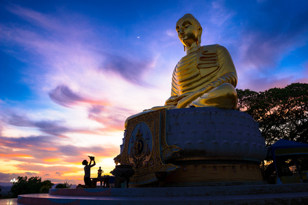 Big Golden Buddha statue Sitting on Lotus meaning at Sunset, Prachuap khiri khan Province Thailand Reklamní fotografie