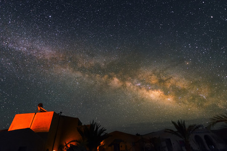 Milky Way above the village near Sahara Desert  at Night, Morocco