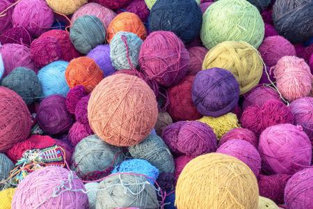 colorful wool yarn silk balls for weaving  knitting  fabrics in cusco, peru Фото со стока
