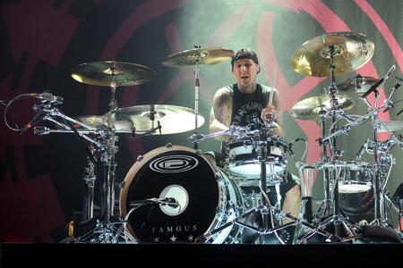 barker: PRAGUE, CZECH REPUBLIC - AUGUST 15, 2014: Drummer Travis Barker of Blink 182 During a performance in Prague, Czech Republic, August 15, 2014.
