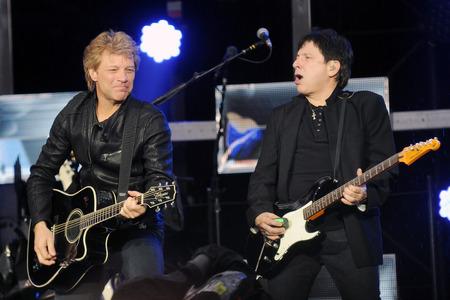 hardrock: PRAGUE, CZECH REPUBLIC - JUNE 24, 2013: Famous American singer Jon Bon Jovi (left) and guitarist Richie Sambora (right) of rock band Bon Jovi During a performance in Prague, Czech Republic, June 24, 2013. Editorial