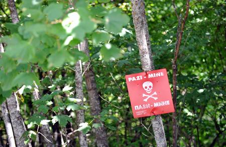 Danger mine sign Stock Photo