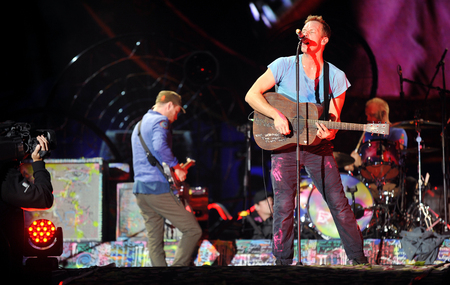 PRAGUE, CZECH REPUBLIC - SEPTEMBER 16, 2012: Singer Chris Martin (right) of famous British band Coldplay During a performance in Prague, Czech Republic, September 16, 2012.