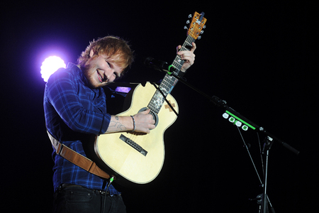 PRAGUE, CZECH REPUBLIC - FEBRUARY 12, 2015: British singer Ed Sheeran During the his performance in Prague, Czech Republic, February 12, 2015.