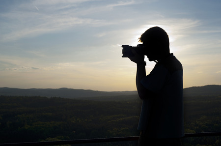 dimming: Silhouette of photographer
