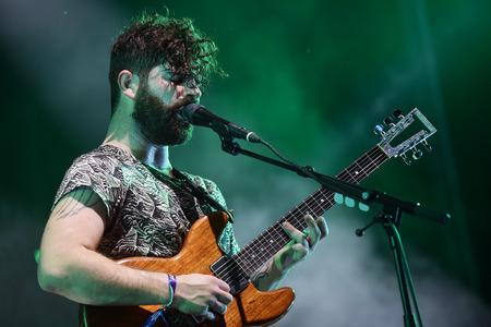 PRAGUE, CZECH REPUBLIC - JUNE 26, 2016: Singer and guitarist Yannis Philippakis of English band Foals During a performance at Metronome Festival in Prague, Czech Republic, June 26, 2016.