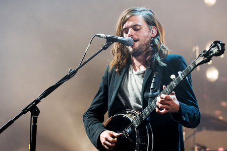 PRAGUE, CZECH REPUBLIC - MAY 20, 2016: Singer and banjoist Winston Marshall of Mumford and Sons During a performance in Prague, Czech Republic, May 20, 2016.