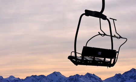 dimming: Ski lift chair in a mountains