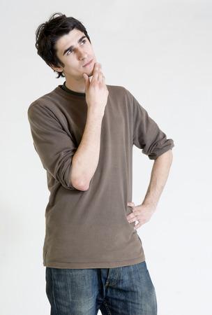 speculative: Thinking young man Stock Photo