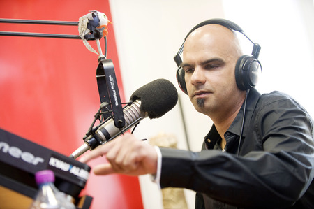 shah: PRAGUE, CZECH REPUBLIC - APRIL 29, 2011: German DJ Roger Shah poses for photo in the radio studio in Prague, Czech Republic, April 29, 2011.