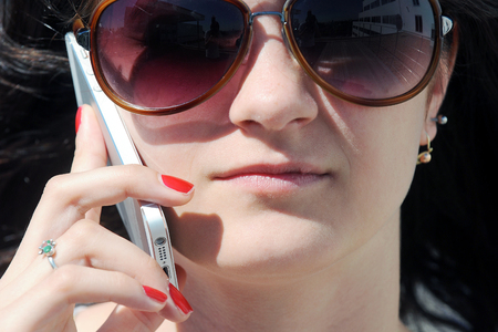 Young woman phoning Stock Photo
