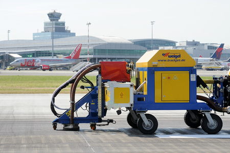 tire marks: Special vehicle cleans runway at the airport in Prague, Czech republic, June 27, 2014.