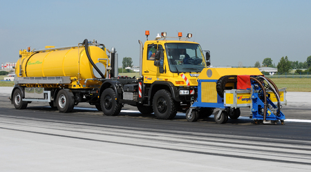 skidding: Special vehicle cleans runway at the airport in Prague, Czech republic, June 27, 2014.