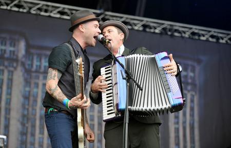 PRAGUE, CZECH REPUBLIC - JUNE 23, 2011: Nathen Maxwell (left) and Matt Hensley (right) of Flogging Molly During a performance at Prague City Festival in Prague, Czech Republic, June 23, 2011.