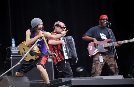 lead guitar: PRAGUE, CZECH REPUBLIC - JUNE 23, 2011: Eugene Hutz (left) Sergey Ryabtsev (middle) and Thomas Goben (right) of Gogol Bordello During a performance at Prague City Festival in Prague, Czech Republic, June 23, 2011.