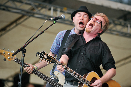 molly: Hradec Kralove, CZECH REPUBLIC - JULY 5, 2012: Singer and guitarist Dave King (right) of Flogging Molly During a performance at Rock for People festival in Hradec Kralove, Czech Republic, July 5, 2012.