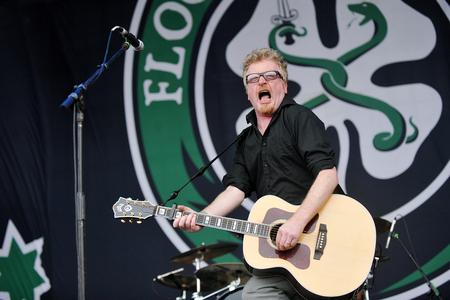 molly: Hradec Kralove, CZECH REPUBLIC - JULY 5, 2012: Singer and guitarist Dave King of Flogging Molly During a performance at Rock for People festival in Hradec Kralove, Czech Republic, July 5, 2012.