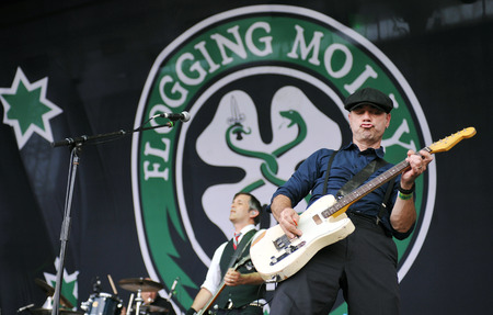 molly: Hradec Kralove, CZECH REPUBLIC - JULY 5, 2012: Bob Schmidt (left) and Dennis Casey (right) of Flogging Molly During a performance at Rock for People festival in Hradec Kralove, Czech Republic, July 5, 2012. Editorial