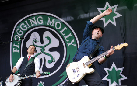 Hradec Kralove, CZECH REPUBLIC - JULY 5, 2012: Bob Schmidt (left) and Dennis Casey (right) of Flogging Molly During a performance at Rock for People festival in Hradec Kralove, Czech Republic, July 5, 2012. Editorial
