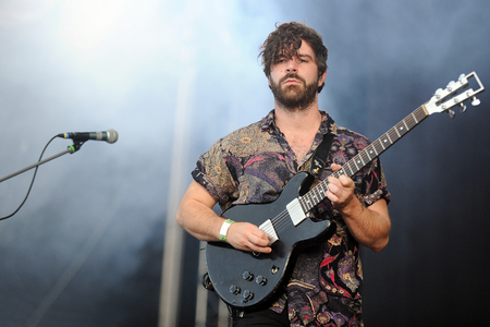 lead guitar: Hradec Kralove, CZECH REPUBLIC - JULY 4, 2013: Singer and guitarist Yannis Philippakis of English band Foals During a performance at Rock for People festival in Hradec Kralove, Czech Republic, July 4, 2013.