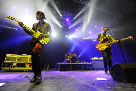 reynolds: Hradec Kralove, CZECH REPUBLIC - JULY 4, 2013: Guitarist Simon Taylor-Davies (L) and singer and bass guitarist Jamie Reynolds (R) of English band Klaxons During a performance at Rock for People festival in Hradec Kralove, Czech Republic, July 4, 2013.