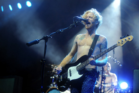 Hradec Kralove, CZECH REPUBLIC - JULY 3, 2014: Bass guitarist James Johnston of Biffy Clyro During a performance at Rock for People festival in Hradec Kralove, Czech Republic, July 3, 2014.