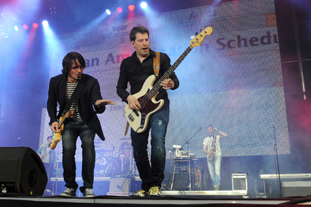 Hradec Kralove, CZECH REPUBLIC - JULY 4, 2014: Singer Michael Malátný (left) and bass guitarist Ondrej Skoch (right) of popular Czech band Chinaski During a performance at Rock for People festival in Hradec Kralove, Czech Republic, July 4, 2014.