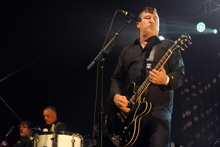 lead guitar: Hradec Kralove, CZECH REPUBLIC - JULY 4, 2014: Singer and guitarist Greg Dulli (right) of famous American band The Afghan Whigs During a performance at Rock for People festival in Hradec Kralove, Czech Republic, July 4, 2014. Editorial