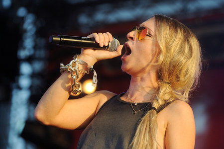 PILSEN, CZECH REPUBLIC - JULY 4, 2015: Singer Sandra Nasic of Guano Apes During a performance at the festival Rock for People in Europe Pilsen, Czech Republic, July 4, 2015.