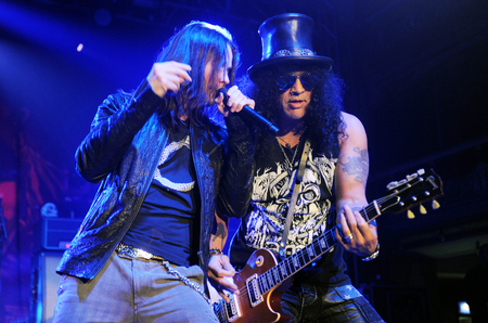 PRAGUE, CZECH REPUBLIC - FEBRUARY 11, 2013: Singer Myles Kennedy (left) and guitarist Saul Hudson aka Slash (right) During a performance in Prague, Czech Republic, February 11, 2013. Editorial