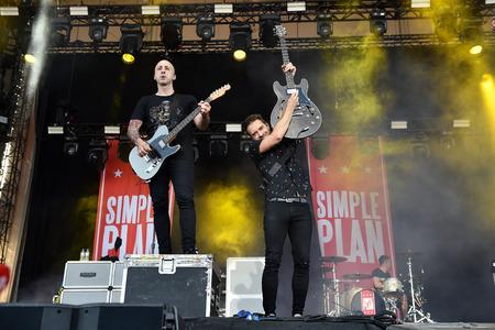 PRAGUE, CZECH REPUBLIC - JUNE 11, 2017: Guitarists Jeff Stinco (left) and Sebastien Lefebvre (right) of Simple Plan at the Aerodrome festival in Prague, Czech Republic, June 11, 2017.