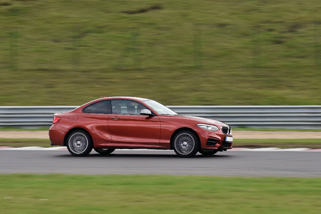 sportcar: MOST, CZECH REPUBLIC - OCTOBER 23, 2017: Red BMW M240i riding on the Most circuit in Czech republic, October 23, 2017. Editorial