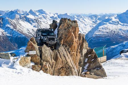 SOLDEN, AUSTRIA - NOVEMBER 16, 2018: Land Rover Defender from James Bond movie Specter near Solden, Austria, November 16, 2018.