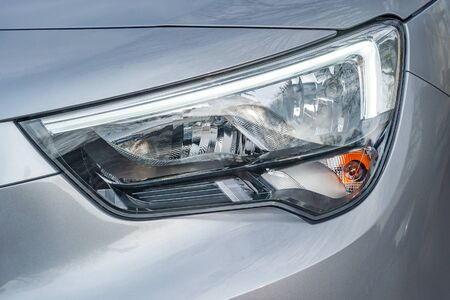 Front light of a silver car