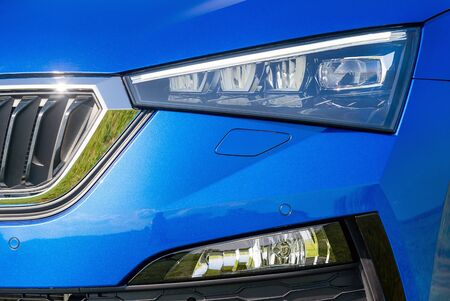 Front lights of a blue car Stockfoto