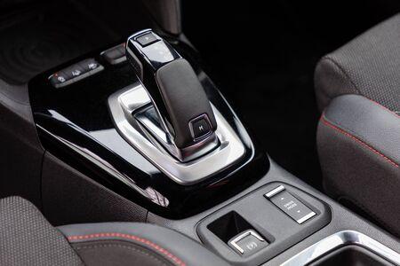 Gear shift in a new modern car Archivio Fotografico