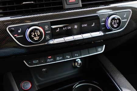 Control buttons on dashboard of a car