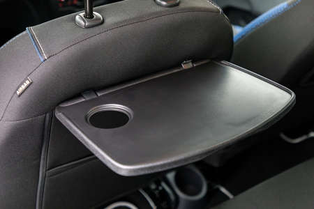 Foldable table in interior of a car Stock Photo