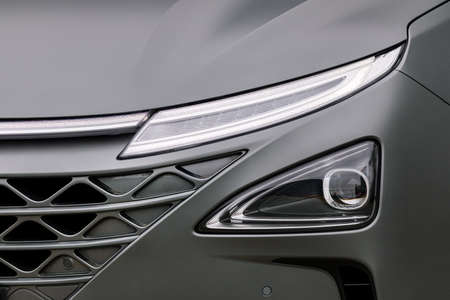 Front light of a grey car