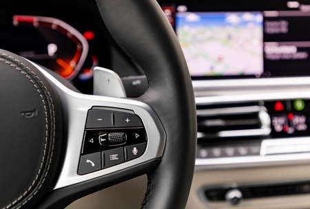 Buttons on steering wheel in a new modern car