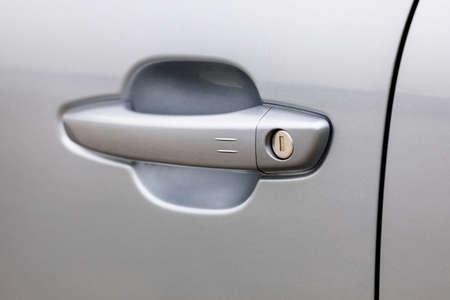 Door handle of a new silver car