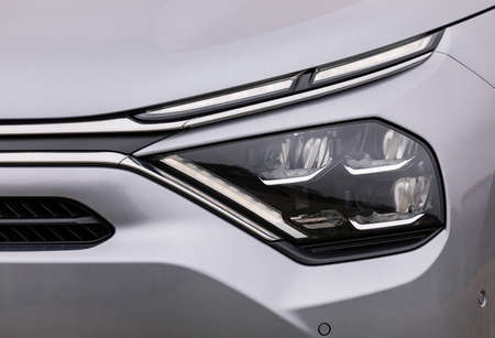 Front lights of a silver car, LED technology