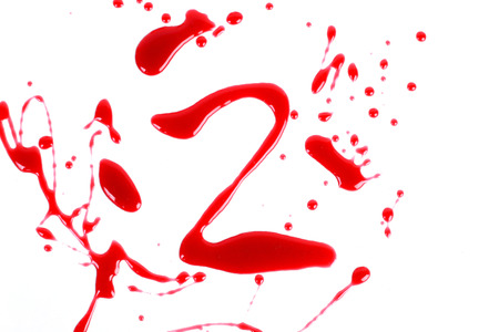 bloody hand print: Bloody print on a white background with the letters 2 Stock Photo