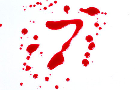 Bloody print on a white background with the letters 8 photo