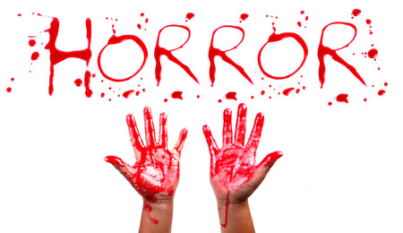 Bloody print on a white background with the letters HORROR photo