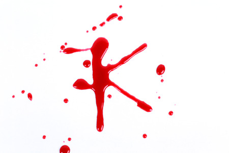 Bloody print on a white with the letters K photo