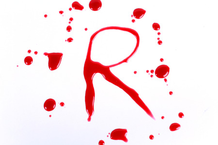 Bloody print on a white with the letters R Stock fotó - 22912536