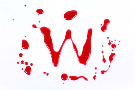 Bloody print on a white background with the letters W photo