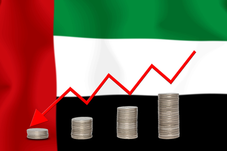 downturn: The economic going down of the United Arab Emirates, with a head shot arrows down from the top medals. Stock Photo